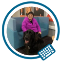 Picture of Tina Lowe, UCD's Campus Accessibility Officer, alongside her guide dog, Forest