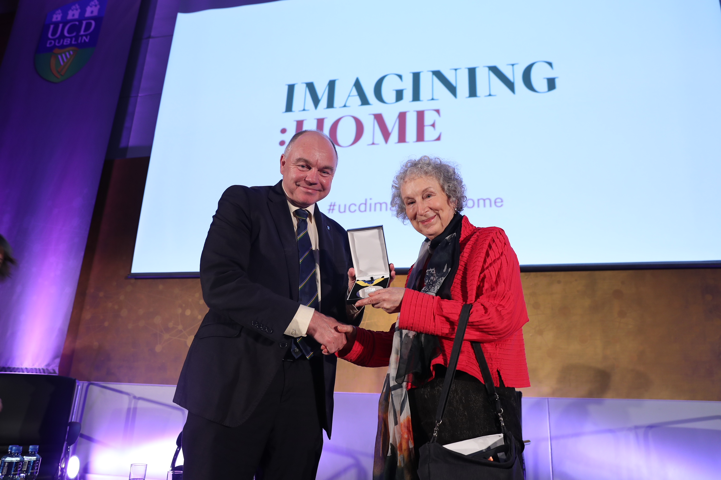 A photo of Margaret Atwood and her Ulysses Medal with President Andrew Deeks
