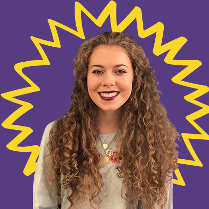 UCD student smiling against a purple background.