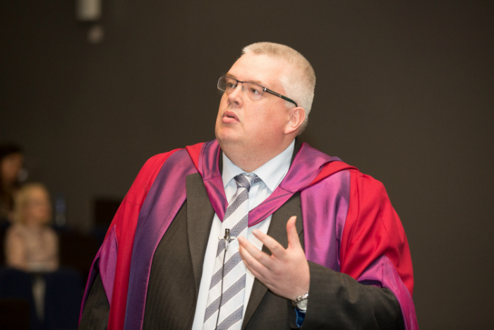 Prof James Devenney