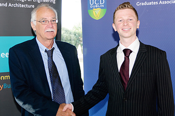Winner of the 2012 Pat McAdam Scholarship,Karl Brennan, congratulated by Dr Dermot Malone.