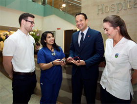 Pictured above (l-r): Robert Smith, UCD student; Dr Aziemah Ali; Minister for Health, Leo Varadkar TD; Mollie Bruton, UCD student.