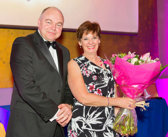 Prof Andrew Deeks presents Ms Helen Stewart with a bouquet of flowers to mark her 20 years of service for UCD School of Medicine at National Maternity Hospital at the UCD Medicine 2015 Gala Dinner.