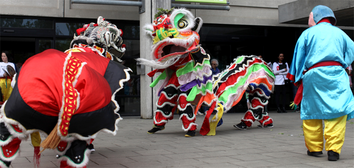 Images of dancing dragons at the UCD Festival