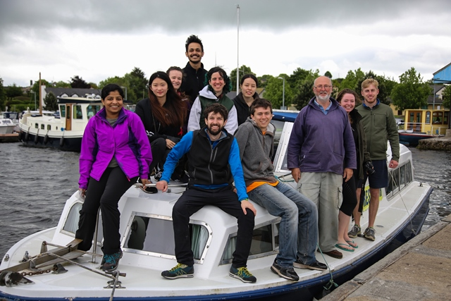Various MSc students on a boat