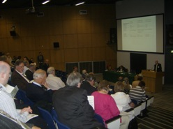 Sir George Quigley addressing the audience at the 2009 conference