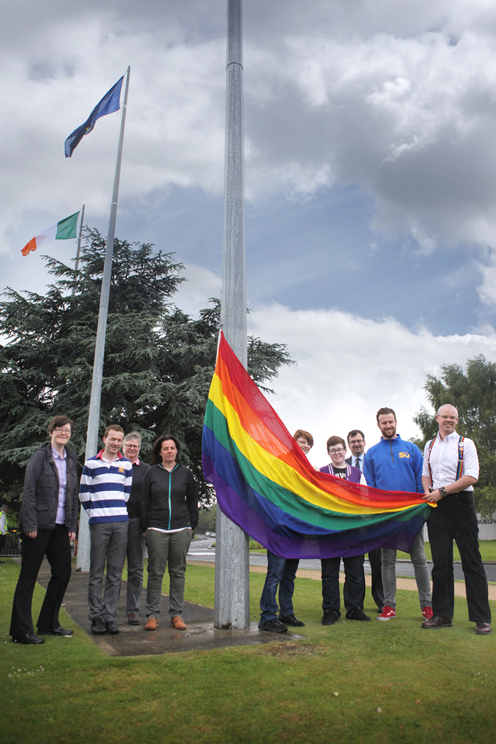 UCD Staff and Students raise the rainbow flag as part of Dublin Pride week