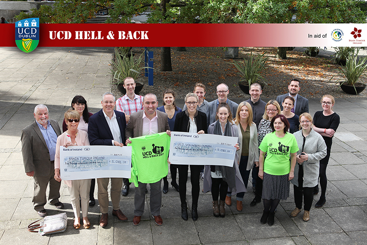 UCD employees hand over a cheque for 10,000 to UCD Volunteers Overseas and Brain Tumour Ireland