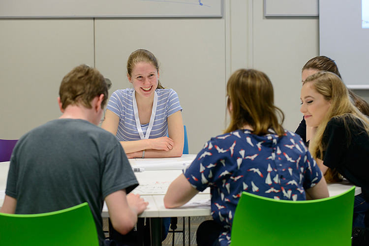 Current undergraduate student Emily Lewanowski-Breen helping some of the participants at the Maths Workshop