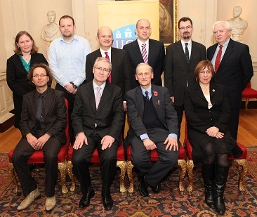 Standing, left to right: Mary Shayne (researcher), Mark Hargaden (IT consultant), Cathal Guiomard (Aviation Regulator), Dr. Muiris MacCarthaigh (research officer), Dr. Colin Scott (associate investigator), Prof. Neil Collins (UCC).